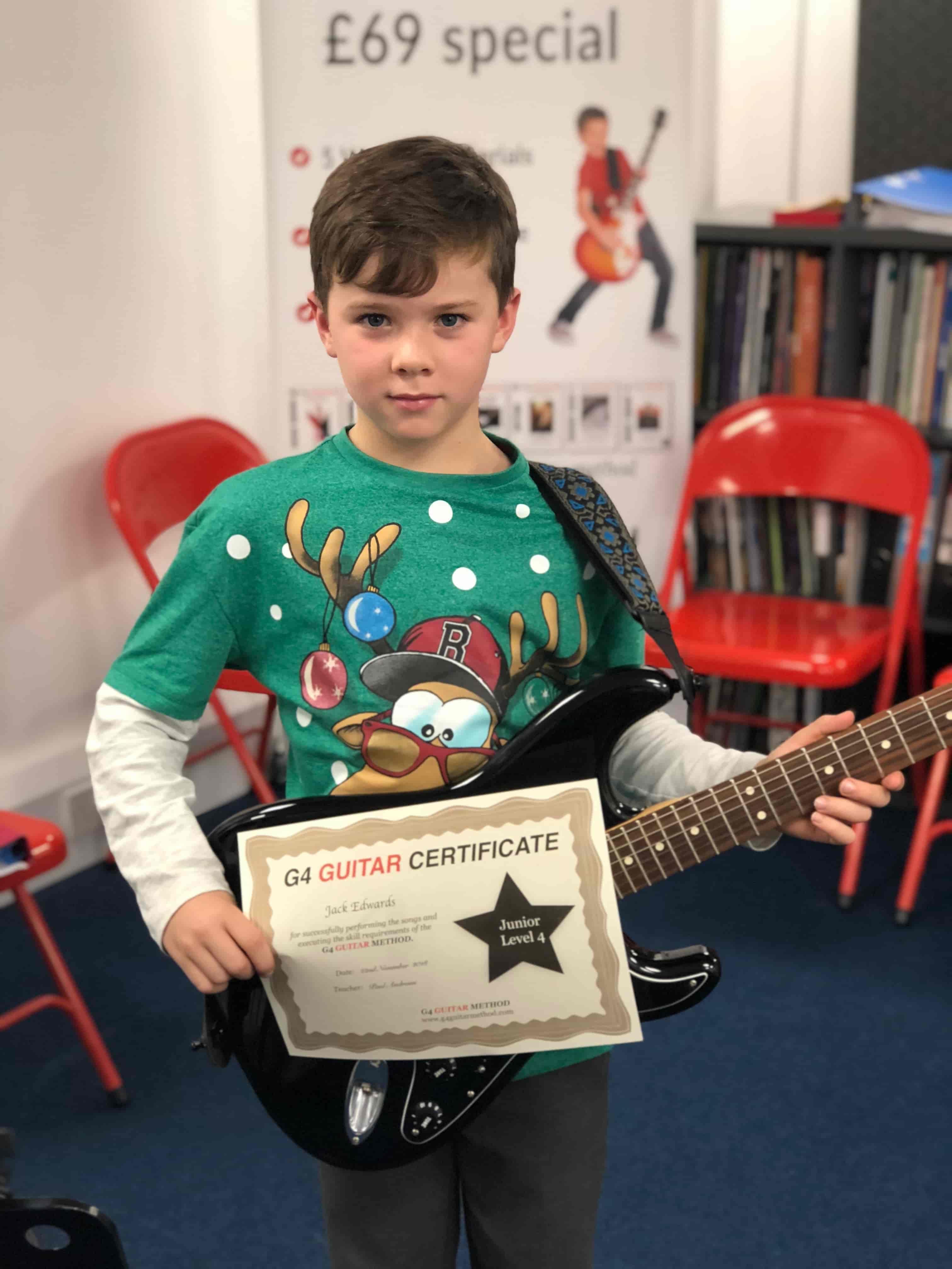 jack-holding-guitar-certificate
