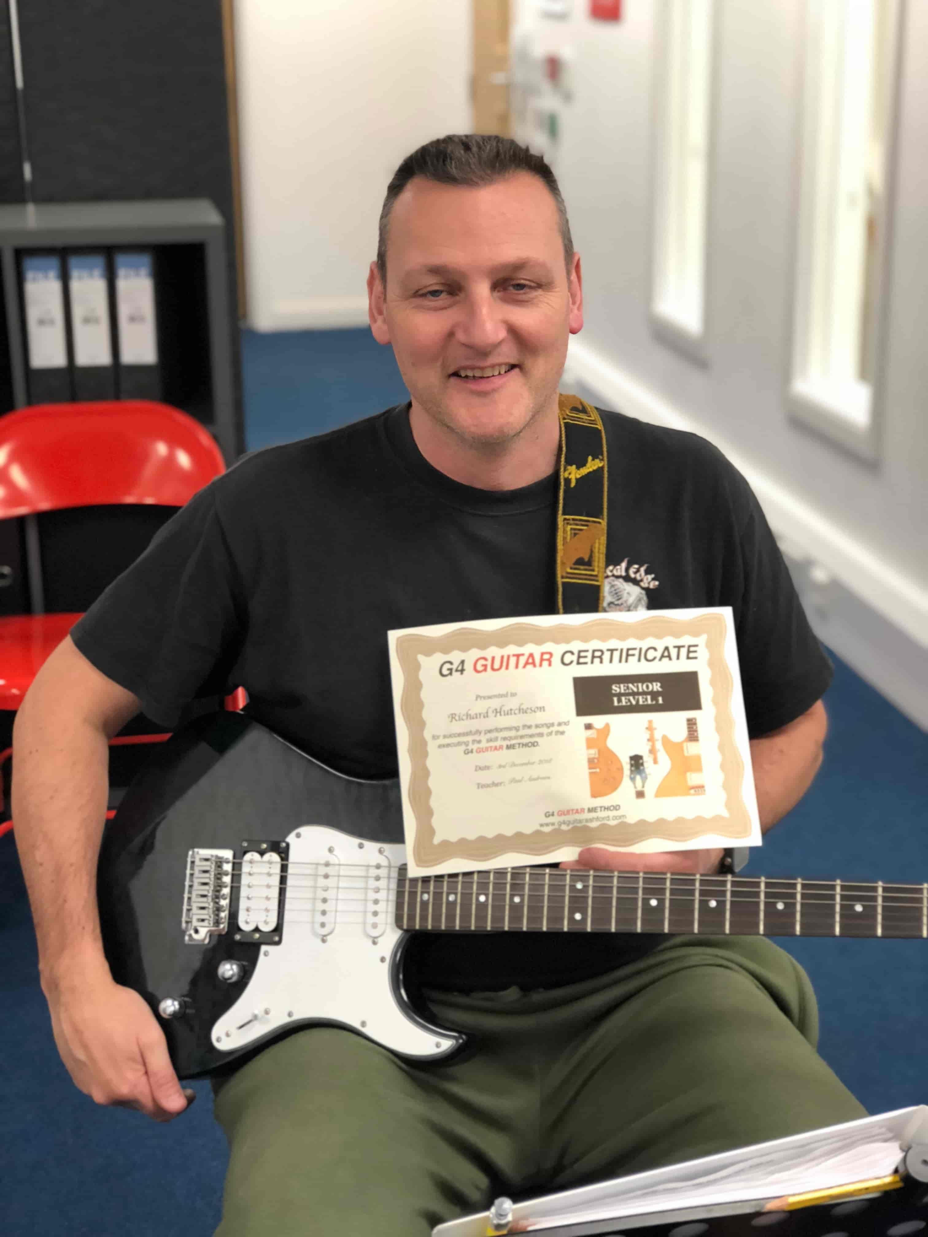 richard-holding-guitar-certificate